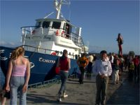 Patsy Dan bidding Sl�n go foill to departing visitors on the Ferry back to mainland Donegal