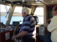 The wheelhouse of the Tory Island Ferry showing latest navigation and radio equipment
