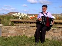 Patsy Dan playing the accordian on Tory Island